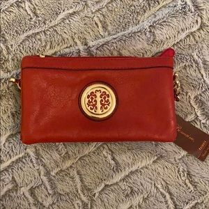 Red leather purse with gold detail
